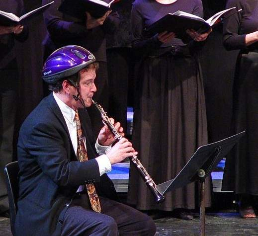 Oboist with bicycle helmet