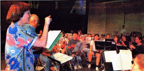 A photo of Gwyneth Walker, Robert Genualdi and the Greater Bridgeport Symphony Youth Orchestra