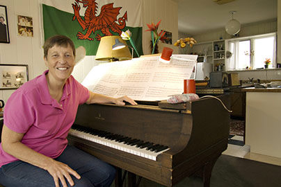 A photo of composer Gwyneth Walker in her studio